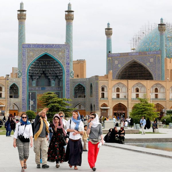 Tourists visit the historical Naqsh-e Jahan Square in Isfahan on April 12, 2018. / AFP PHOTO / ATTA KENARE        (Photo credit should read ATTA KENARE/AFP/Getty Images)